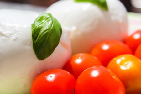 fresh and tasty dish based on tomato mozzarella and basil Standard-Bild