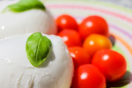 fresh and tasty dish based on tomato mozzarella and basil Stock Photo