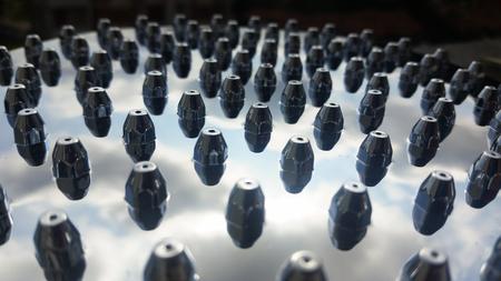 closeup of shower tray nozzles