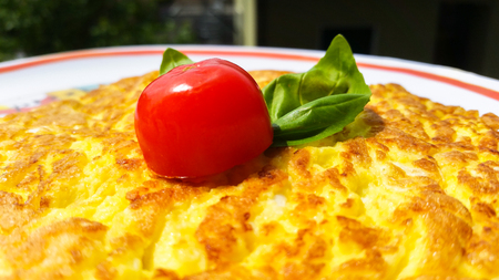 omelette with fresh tomato and basil Stock Photo