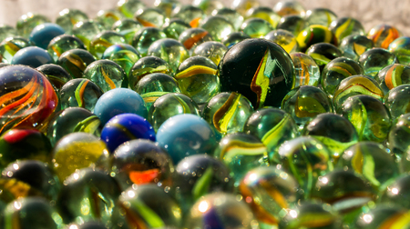 collection of glass marbles of many colors