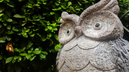 a stone owl with an indecipherable look Stock fotó
