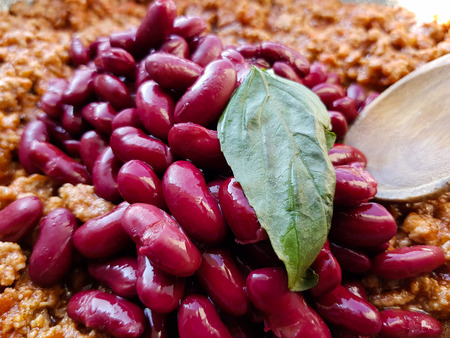 tasty dish of beans with beef and basil leaf