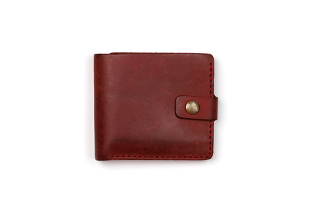 Closed red leather wallet on a white background Banco de Imagens