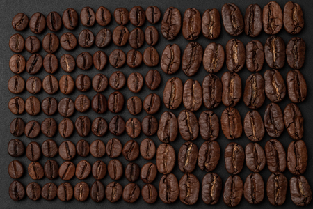 Roasted coffee beans on black background
