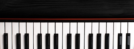 synthesizer keyboard on black wooden background with empty space for text. 写真素材