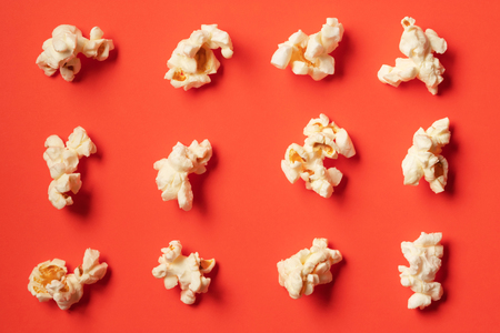 Popcorn pattern on red background. Flat lay
