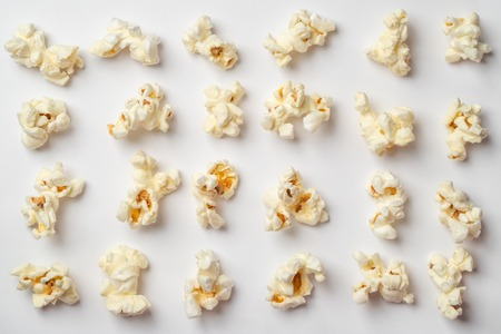 Popcorn pattern on white background. Flat lay