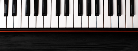 synthesizer keyboard on black wooden background with empty space for text. Banco de Imagens