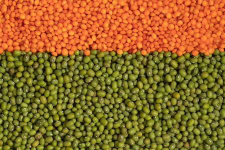 Orange and green lentils full background, top view