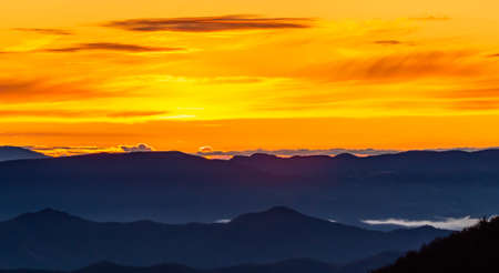 A new day begins, we see an early sunrise observed from the peaks of the Apennine Mountains.