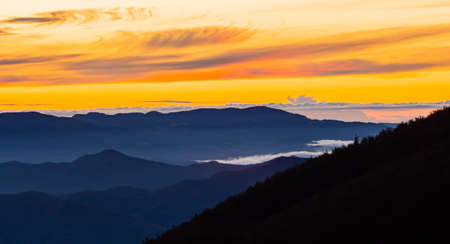 Here we see a new day awakening, flooding all mountain peaks with sunlight.