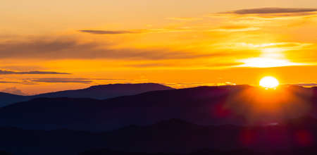 In this picture we see a beautiful sunrise seen from a mountain peak in central Italy.