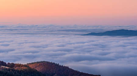 Here we see the clouds hugging the mountain peaks creating a visual illusion of sea waves.
