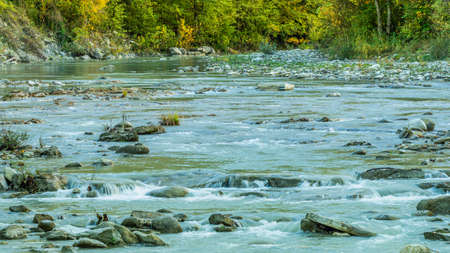 The beautiful mountain river that flows through the tiny town of Santa Sofia in central Italy is a paradise for mountain fishermen. 版權商用圖片