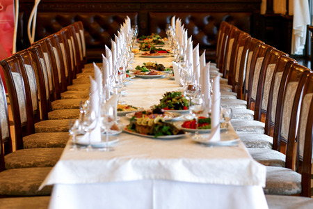 stylish table with food and drinks setting for guests at elegant  wedding reception, catering in restaurant