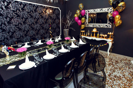 stylish luxury decorated set tables at the golden birthday party, holiday celebration concept