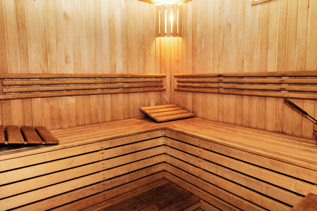 Wooden russian bathhouse sauna benches in hospital recreational room, relaxing leisure in bath-house equipment, hot steam concept