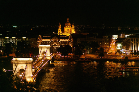 beautiful night view of chain bridge and river and city lights in Budapest city,  travel concept, space for text