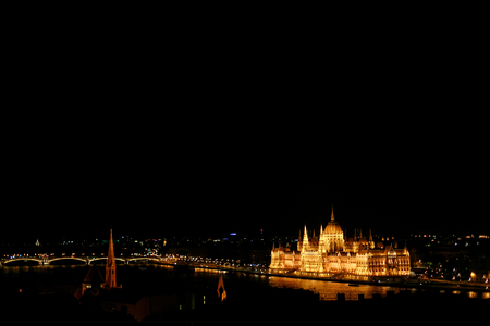 amazing night view of old  parliament building and river and city lights  in Budapest city, travel concept, space for text Reklamní fotografie