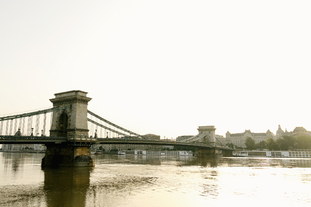 amazing  view of old bridge at river in the morning light in Budapest city, travel concept, space for text
