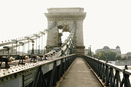 amazing  view of old bridge at river and sidewalk in the morning light in Budapest city, travel concept, space for text