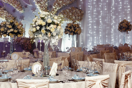 luxury wedding decor with flowers and glass vases with jewels on round tables. arrangements of decorations at wedding reception. expensive catering. space for text Фото со стока - 75661383