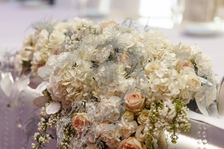 royal wedding: luxury decorated tables with hydrangea and roses at rich wedding reception. stylish arrangements of flowers and jewels on table, expensive catering. space for text