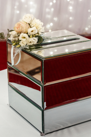 luxury wedding gift box with roses and expensive golden decor arrangements at wedding ceremony. greeting for bride and groom. expensive catering. space for text. wedding reception