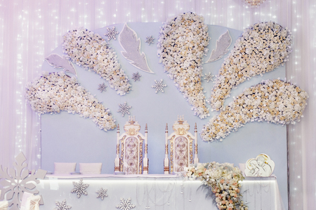 royal wedding: luxury decorated centerpiece for bride and groom with hydrangea and roses at rich wedding reception. golden stylish arrangements of flowers and jewels, expensive catering. space for text