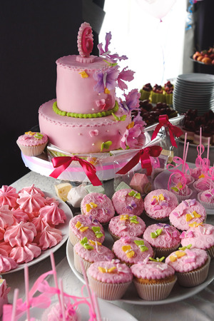 sugarpaste: luxury delicious pink cupcakes and candy bar at celebration, party in a restaurant Stock Photo