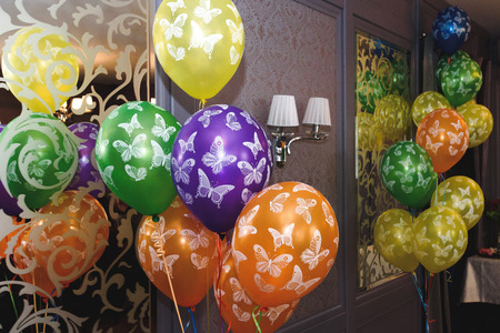 Many Colorful Balloons With Butterflies Decoration In Restaurant