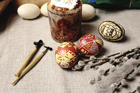 easter bread, wax painted colorful eggs, wooden sticks, buds on branches, springtime, holiday card