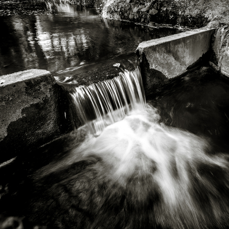 beautiful river waterfall in summer green park, environment concept, black and white