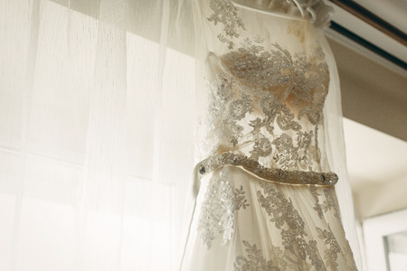 Beautiful White Wedding Dress Hanging Near A Window In Hotel.. Stock ...