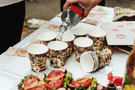 wedding feast: stylish wedding table with delicious sandwiches and alcohol, cake and bouquet