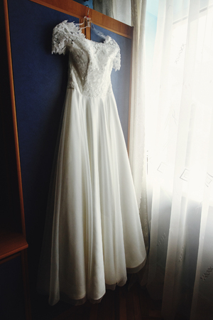 Beautiful White Luxury Wedding Dress On Hanger On The Background ...