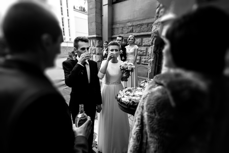 happy bride and groom toasting and laughing, funny moment,  gorgeous wedding reception