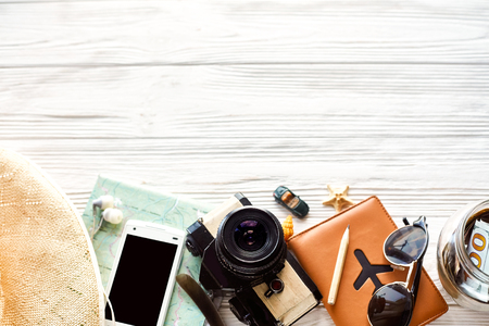 summer travel wanderlust concept, space for text, flat lay. map camera sunglasses  passport money phone hat shells car toy on white wooden background top view. hello holiday, planning vacation 스톡 콘텐츠