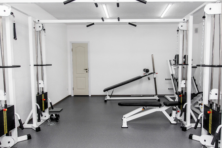 rehabilitation equipment in therapy clinic. modern gym weight training equipment for exercises and rehab. fitness wellness concept. space for text