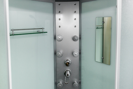 new shower cabin in physiotherapy rehab clinic. modern rehabilitation equipment. fitness wellness hygiene concept. space for text. public shower room