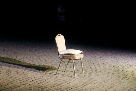 one chair with pillow at wedding reception, for traditional veil ceremony