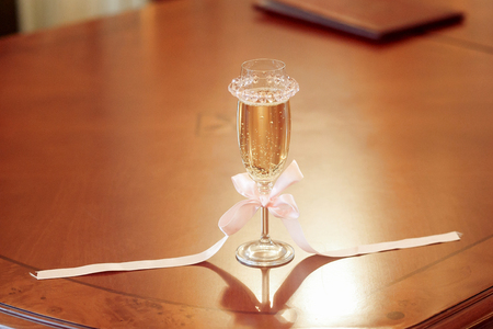 champagne glass on table for wedding ceremony register, catering at reception