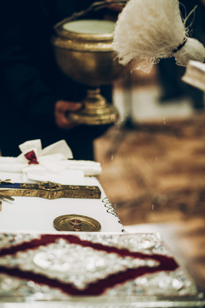 priest blessing golden wedding rings on altar in church during wedding ceremony Stock Photo