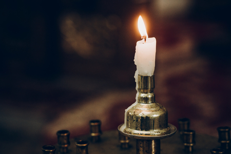 candle light, flaming on altar in church. wedding ceremony, holy moment. mourning. hope