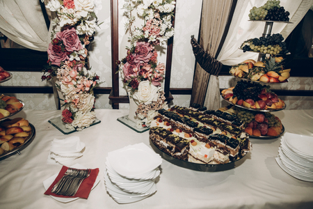 Candy Bar Table At Wedding Reception With Stylish Flowers Decor ...
