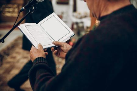 priest reading bible book in church during wedding ceremony 版權商用圖片