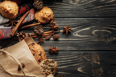 cookies cupcakes and spices on wooden background, stylish rustic winter flat lay. space for text. cozy mood autumn. seasonal holidays bakery concept