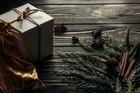 christmas simple present box and thread on stylish rustic wooden background with space for text. greeting card concept. seasonal greetings winter holidays Stock Photo
