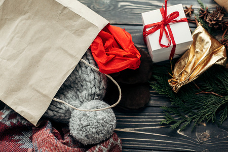 clothing store: christmas shopping concept. big sale. seasonal rustic background with bags of buyed clothes presents. advertising with space for text